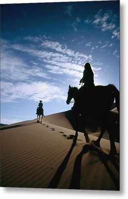 Horseback Riders In Silhouette On Sand Metal Print by Axiom Photographic