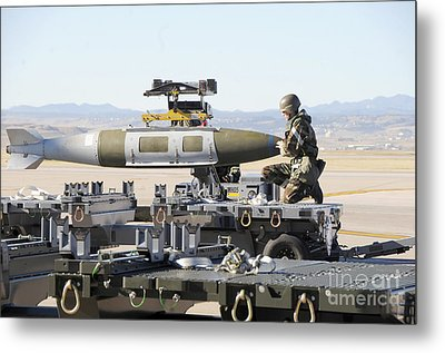 Irman Assists In Lowering A Guided Bomb Metal Print by Stocktrek Images