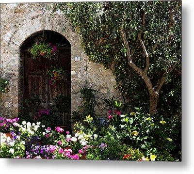 Italian Front Door Adorned With Flowers Metal Print by Marilyn Hunt
