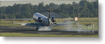 Jet Plane Landing On Runway With Tires Smoking Metal Print by David Oppenheimer