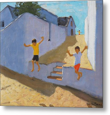 Jumping Off A Wall Metal Print by Andrew Macara