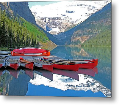 Lake Louise Canoes Metal Print by Gerry Bates