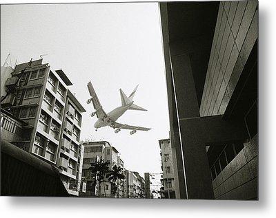 Landing In Hong Kong Metal Print by Shaun Higson