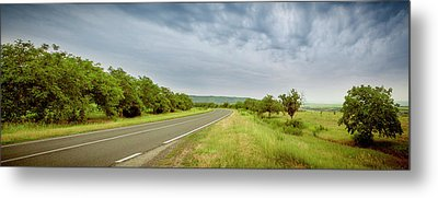 Landscape With Highway And Cloudy Sky Metal Print