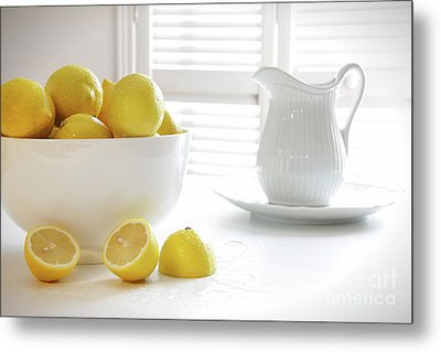 Lemons In Large Bowl On Table Metal Print by Sandra Cunningham