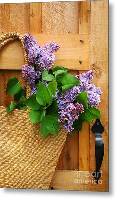 Lilacs In A Straw Purse Metal Print by Sandra Cunningham