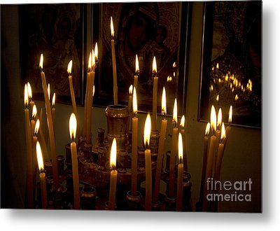 lit Candles in church  Metal Print by Danny Yanai