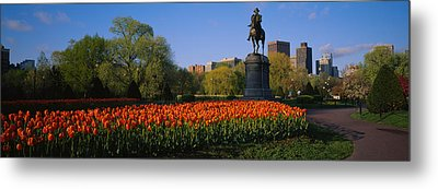 Low Angle View Of A Statue In A Garden Metal Print by Panoramic Images