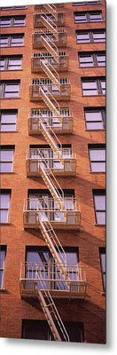 Low Angle View Of Fire Escape Ladders Metal Print by Panoramic Images