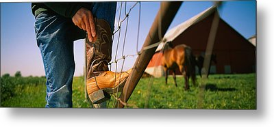 Low Section View Of A Cowboy Adjusting Metal Print