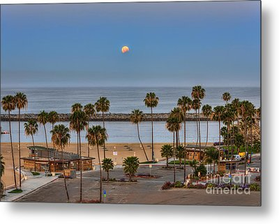 Lunar Eclipse Moonset Metal Print by Eddie Yerkish