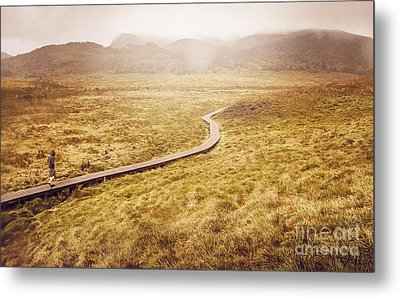 Man On Expedition Along Cradle Mountain Boardwalk Metal Print by Jorgo Photography - Wall Art Gallery
