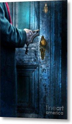 Man With Keys At Door Metal Print by Jill Battaglia