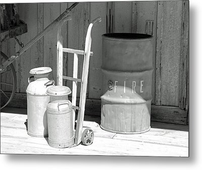 Milk Cans And Fire Barrel Metal Print by Troy Montemayor