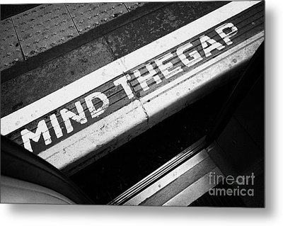 Mind The Gap Between Platform And Train At London Underground Station England United Kingdom Uk Metal Print by Joe Fox