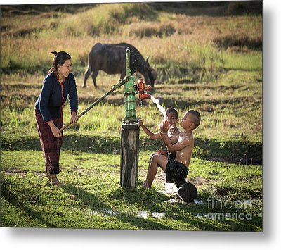 Mother Her Sons Shower Outdoor From Groundwater Pump. Metal Print by Tosporn Preede