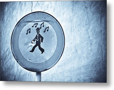 Musicman Walking Metal Print by Keith Sanders