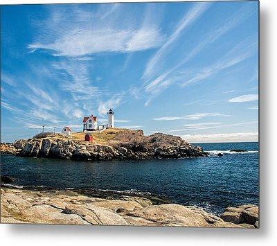 Nubble Lighthouse With Dramatic Clouds Metal Print by Nancy De Flon