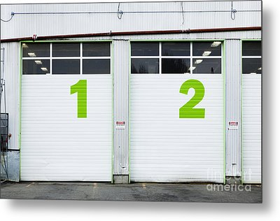 Numbers On Repair Shop Bay Doors Metal Print by Don Mason