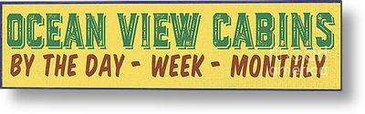 Ocean View Cabins Vintage Sign Metal Print by Edward Fielding