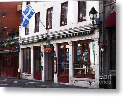 Old Montreal Storefront Metal Print by John Rizzuto