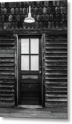 Old Wood Door And Light Black And White Metal Print by Terry DeLuco