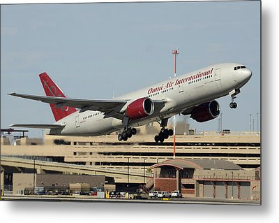 Omni Air International Boeing 777-222 N927ax Phoenix Sky Harbor January 3 2015 Metal Print by Brian Lockett