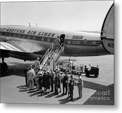 Passengers Boarding A Flight Metal Print by C.S. Bauer/ClassicStock