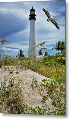 Pelican Flying Over Cape Florida Lighthouse Metal Print