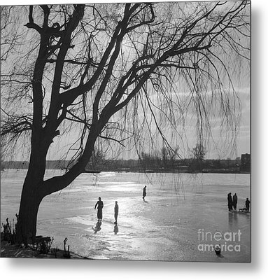 People Ice Skating On A Frozen Over Lake Metal Print