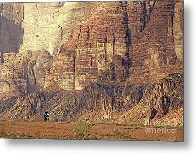 Person Riding A Motorbike Through The Wadi Rum Desert In Jordan Metal Print by Sami Sarkis