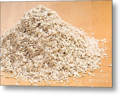 Pile Of Dried Rolled Oat Flakes Spilled  Metal Print by Arletta Cwalina