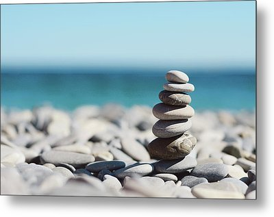 Pile Of Stones On Beach Metal Print by Dhmig Photography