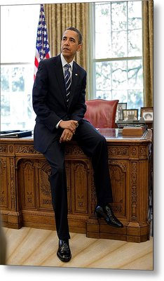 President Barack Obama Sits On The Edge Metal Print by Everett