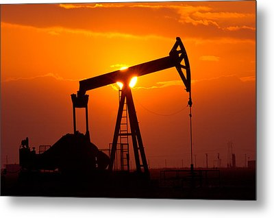 Pumping Oil Rig At Sunset Metal Print