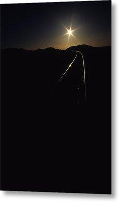Rails At Sunrise Metal Print by Susan  Benson