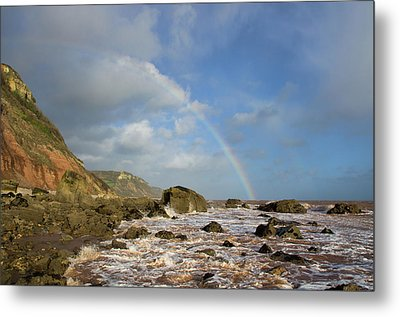 Rainbow Over Dunscombe Cliff Metal Print by Pete Hemington