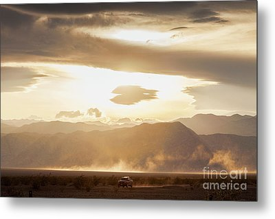 Metal Print featuring the photograph Raising Dust In Death Valley by Colin and Linda McKie