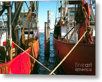 Metal Print featuring the photograph Red Boat Docked In The Bay by John Rizzuto