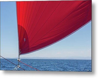 Metal Print featuring the photograph Red Sail On A Catamaran 2 by Clare Bambers