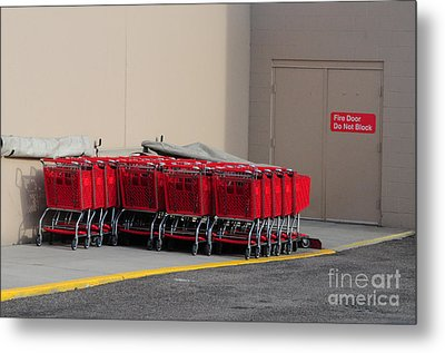 Red Shopping Carts In A Row Metal Print by Merrimon Crawford