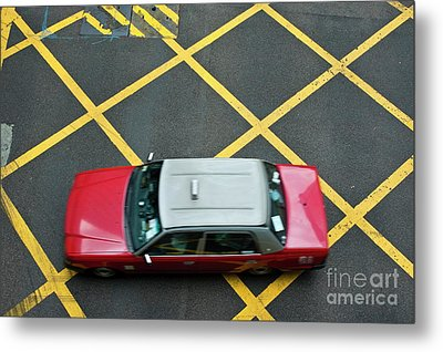 Red Taxi Cab Driving Over Yellow Lines In Hong Kong Metal Print by Sami Sarkis