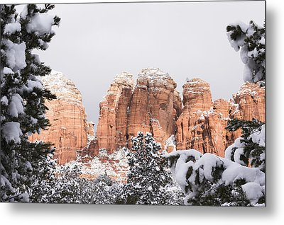 Red Towers Under Snow Metal Print by Laura Pratt