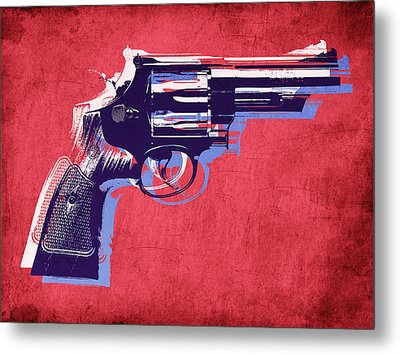 Revolver On Red Metal Print by Michael Tompsett
