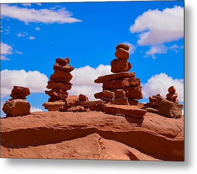 Rock Cairns In The Desert Metal Print by Dany Lison
