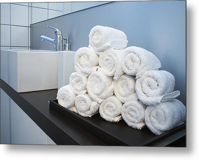 Rolled Towels Stacked In The Shape Of A Pyramid Metal Print by Larry Washburn