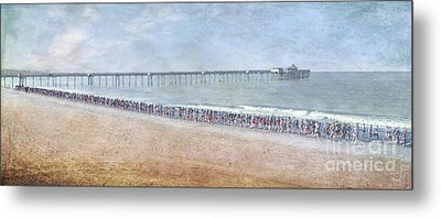 Metal Print featuring the photograph Runners On The Beach Panorama by David Zanzinger