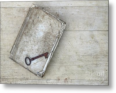 Metal Print featuring the photograph Rusty Key On The Old Tattered Book by Michal Boubin