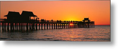 Silhouette Of Huts And A Pier At Dusk Metal Print by Panoramic Images