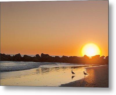 Silhouette Of Rocks On Beach At Sunset Metal Print by Markus Henttonen